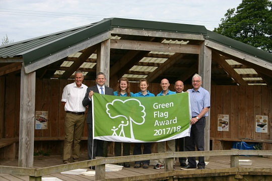 Celebrating the Green Flag award for Seaton Wetlands are, from left, Charlie Plowden (EDDC service lead for countryside and leisure), Cllr Marcus Hartnell (EDDC deputy portfolio holder for the environment), Laura Goble, (EDDC Countryside trainee ranger), Meg Knowles, (EDDC Education ranger), Tim Dafforn (EDDC countryside team leader), John Golding (EDDC strategic lead for housing and environment) and Cllr Tom Wright (EDDC portfolio holder for the environment).