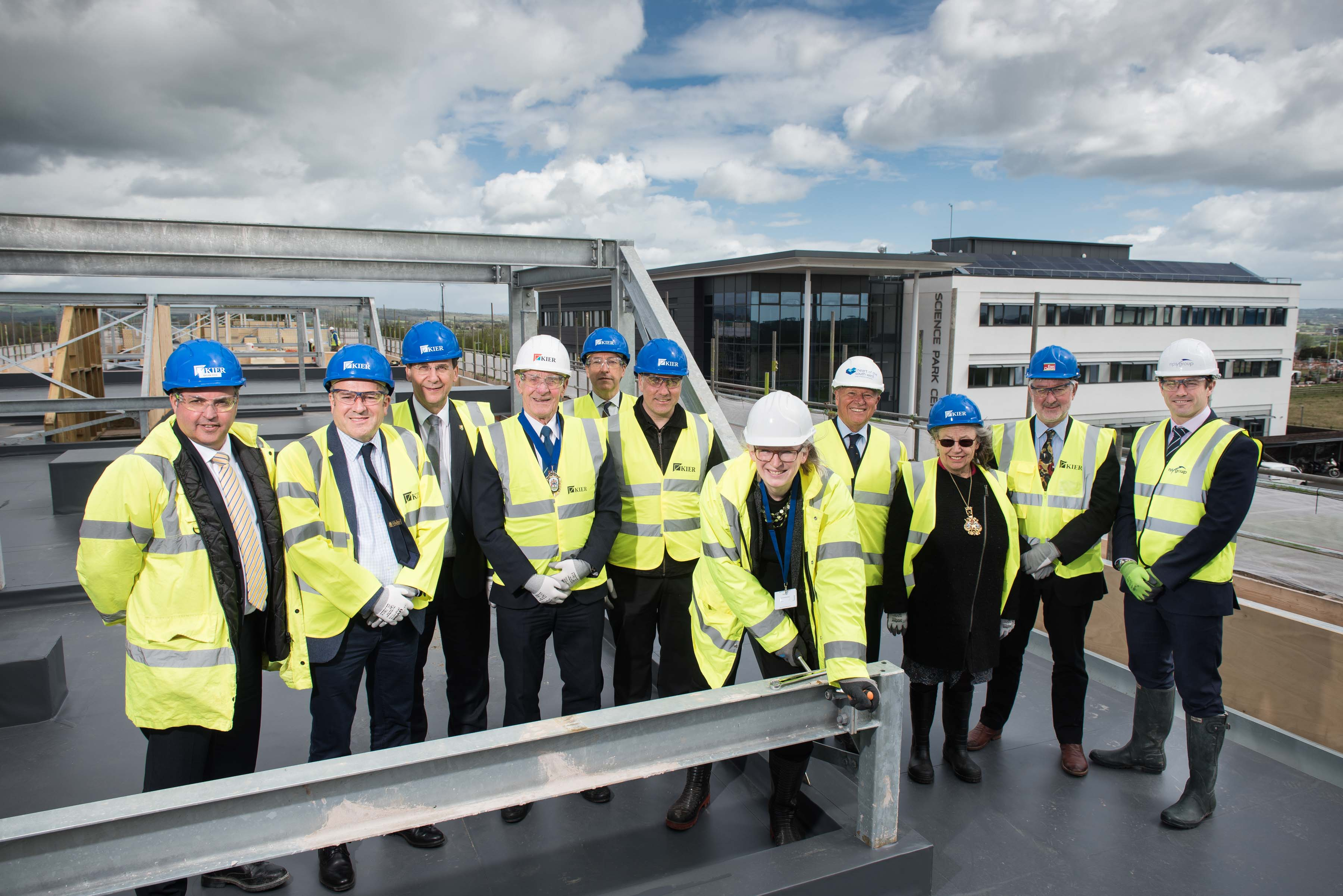 Dr Sally Basker, CEO of Exeter Science Park tightens the last bolt at the topping out ceremony of the Grow on Buildings.