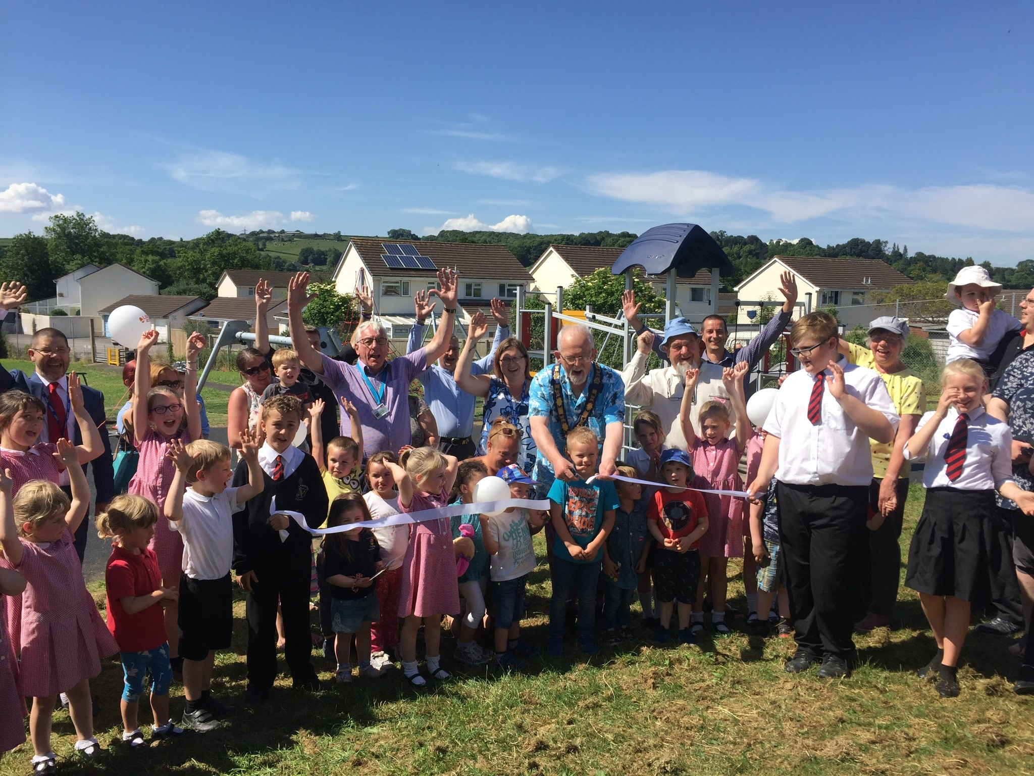 Children and councillors celebrating the opening of Axminster's North Street play area.