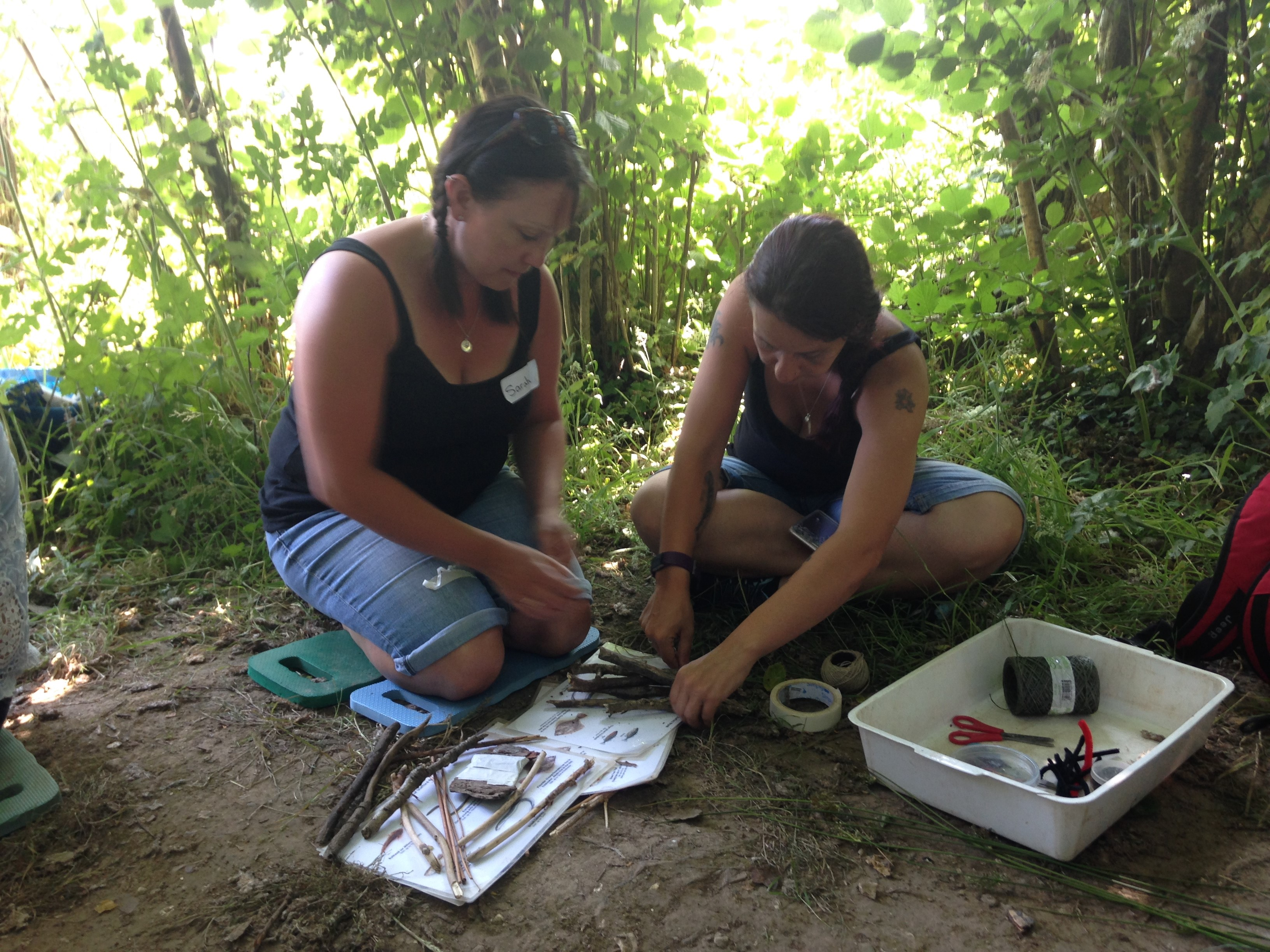 Two female teachers at Seaton Wetlands learning how to take early years education outdoors