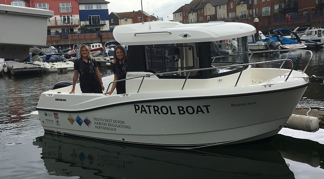 SEDHREC Habitat Mitigation Officers on a new patrol boat for the Exe Estuary