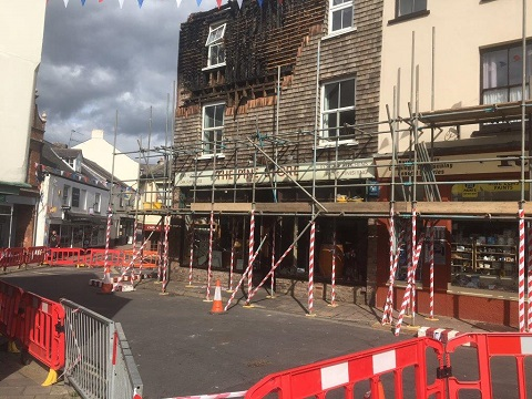 Extensive use has been made of scaffolding to support the fire ravaged Pine Store in Ottery St Mary