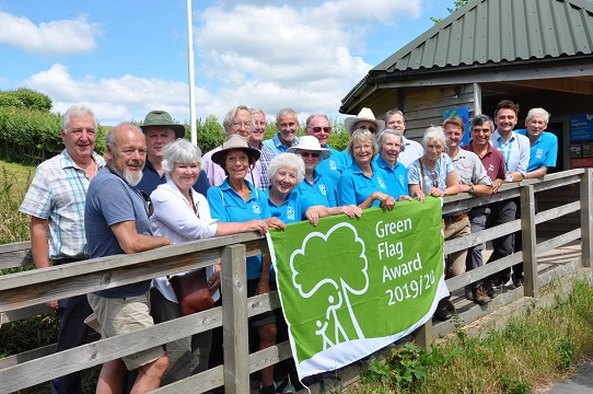 Volunteers, members of East Devon's Countryside team, ward members and East Devon's environment portfolio holder Cllr Jung celebrating Seaton Wetlands' Green Flag Award