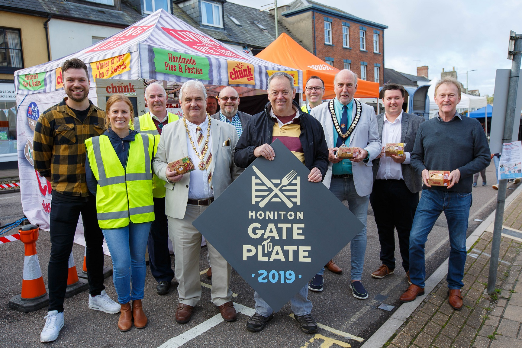 Enjoying Gate to Plate (from left to right) – Ben Atkinson, Heart DJ; Kirsten Rowe, East Devon District Council economy team; Councillor Tony McCollum, East Devon District Council ward member for Honiton St Paul's;  Councillor John Zarczynski, Mayor of Honiton; Councillor Dean Barrow, East Devon District Council ward member for Honiton St Paul's; Councillor Kevin Blakey, East Devon District Council's Portfolio holder for Economy; Andrew Hopkins, East Devon District Council economy team; Councillor Stuart Hughes, Chairman of East Devon District Council; Councillor Luke Jeffrey, East Devon District Council ward member for Honiton St Michael's; Councillor Ben Ingham, Leader of East Devon District Council.