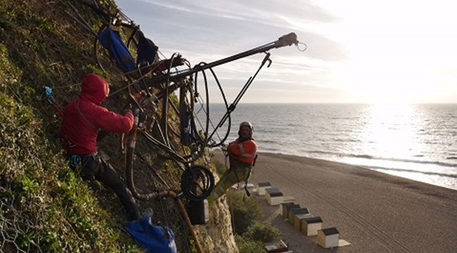 The netting being put in place will help stabilise the cliffs and reduce the risk to the public from falling debris
