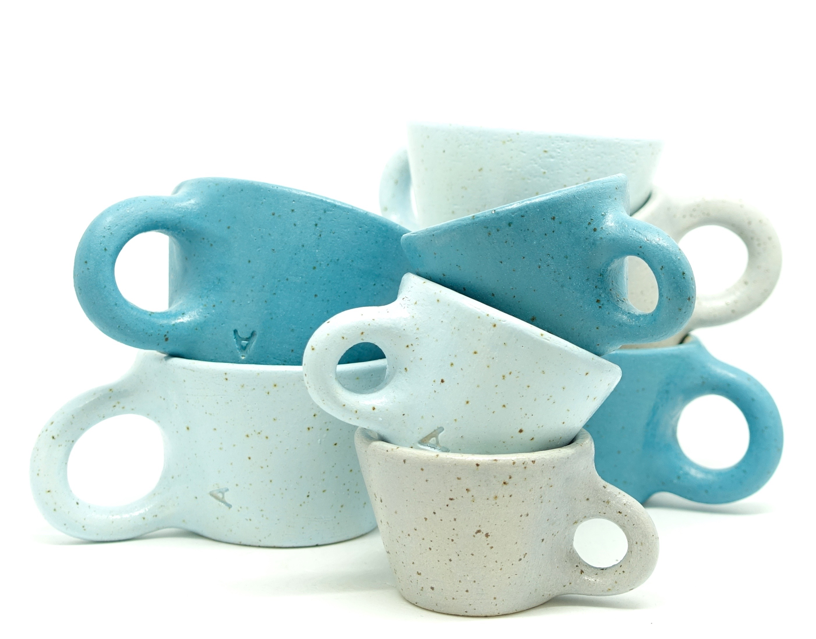 Turquoise and pale blue cups